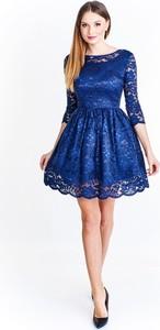 Granatowa sukienka producent niezdefiniowany z okrągłym dekoltem rozkloszowana