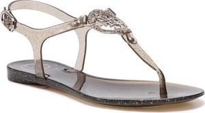 Złote sandały Guess z płaską podeszwą w stylu casual