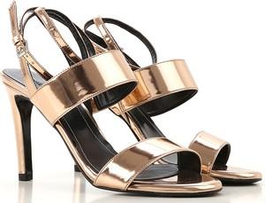 Kendall + Kylie sandały damskie na słupku złote na średnim