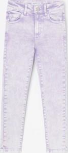 Różowe jeansy Reserved