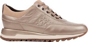 Złote buty sportowe Geox na koturnie