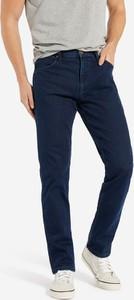 Granatowe jeansy Wrangler z bawełny