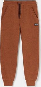 Pomarańczowe spodnie dziecięce Reserved