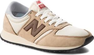 Brązowe buty sportowe new balance sznurowane z płaską podeszwą ze skóry