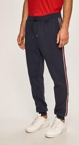 Granatowe spodnie Guess Jeans z bawełny