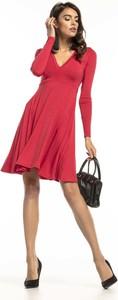 Sukienka Tessita z długim rękawem z dekoltem w kształcie litery v rozkloszowana