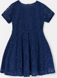 Granatowa sukienka dziewczęca Reserved