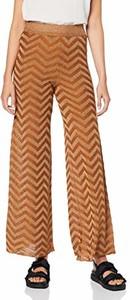 Pomarańczowe spodnie amazon.de w geometryczne wzory w stylu retro