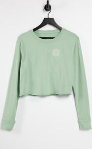 Zielona bluzka Nike w sportowym stylu z bawełny
