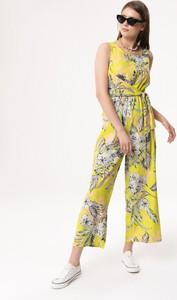 Żółty kombinezon born2be w stylu boho z długimi nogawkami
