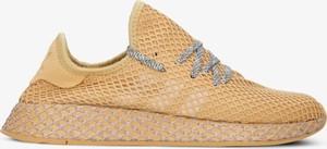 Żółte buty sportowe Adidas z płaską podeszwą w sportowym stylu sznurowane