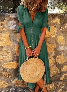 Zielona sukienka Sandbella z dekoltem w kształcie litery v midi w stylu boho