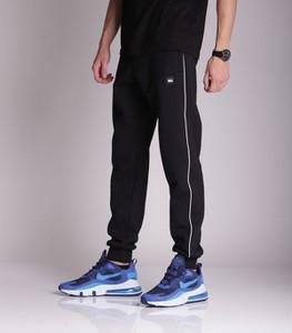 Czarne spodnie sportowe SSG w sportowym stylu