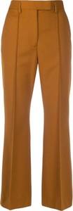 Pomarańczowe spodnie Acne