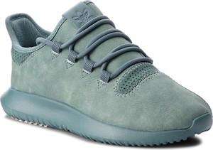 Niebieskie buty sportowe Adidas tubular sznurowane w sportowym stylu