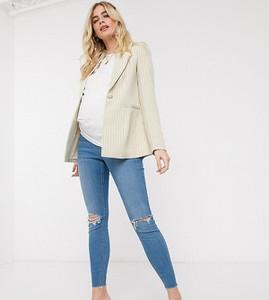 ASOS DESIGN Maternity — Ridley — Jasnoniebieskie obcisłe jeansy z przetarciami, niewykończonym brzegiem i zasłoniętym brzuchem-Biały