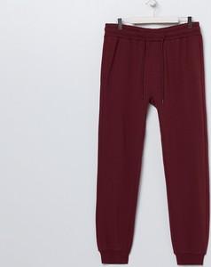 Czerwone spodnie sportowe Sinsay z dresówki