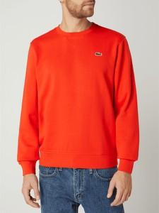 Czerwony sweter Lacoste w stylu casual