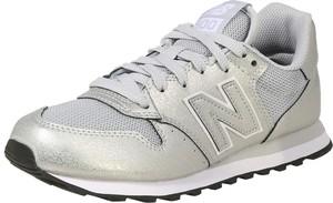 Buty sportowe New Balance ze skóry z płaską podeszwą w sportowym stylu
