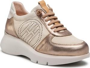 Złote buty sportowe Hispanitas na platformie