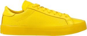 Żółte trampki Adidas w sportowym stylu