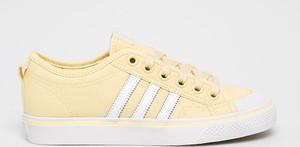 Żółte trampki Adidas Originals z płaską podeszwą sznurowane niskie