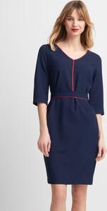 Niebieska sukienka QUIOSQUE mini z dekoltem w kształcie litery v z długim rękawem