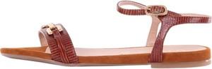 Brązowe sandały Unisa w stylu casual z płaską podeszwą