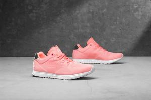 Różowe buty sportowe Reebok sznurowane z płaską podeszwą