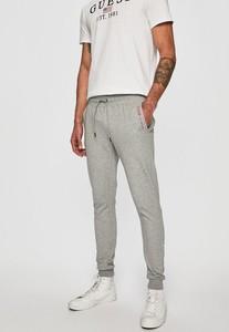 Spodnie Guess Jeans z bawełny