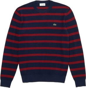 Niebieski sweter Lacoste w młodzieżowym stylu z wełny