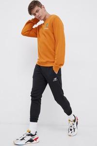 Pomarańczowa bluza New Balance w sportowym stylu
