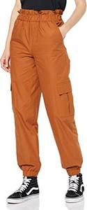 Pomarańczowe spodnie amazon.de w militarnym stylu
