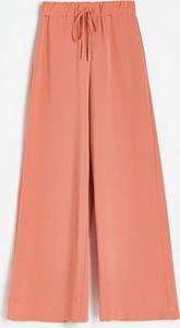 Pomarańczowe spodnie Reserved w stylu retro z tkaniny