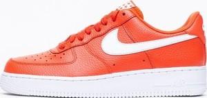 Pomarańczowe buty sportowe Nike sznurowane ze skóry