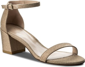 Złote sandały stuart weitzman na obcasie