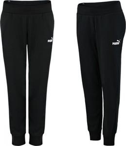 Czarne spodnie Puma z dresówki w sportowym stylu