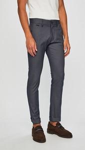 Spodnie Guess Jeans z tkaniny