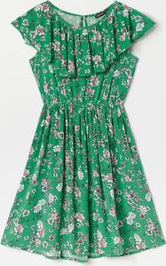 Zielona sukienka dziewczęca Reserved w kwiatki