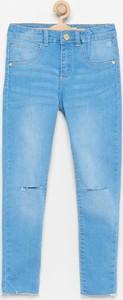 Niebieskie jeansy dziecięce Reserved z jeansu