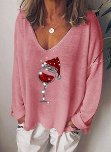 Różowa bluzka Sandbella w bożonarodzeniowy wzór z długim rękawem z dekoltem w kształcie litery v