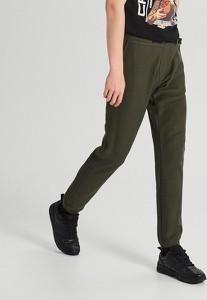 Zielone spodnie sportowe Cropp z dresówki