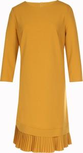 Żółta sukienka Fokus z długim rękawem rozkloszowana midi