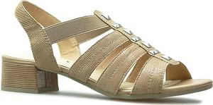 Żółte sandały Caprice ze skóry w stylu casual na obcasie