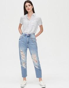 Niebieskie jeansy Cropp w street stylu z jeansu