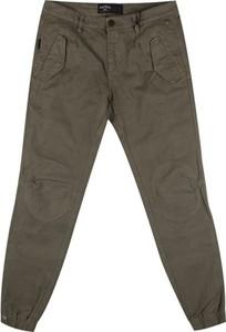 Zielone spodnie Three Stroke Productions