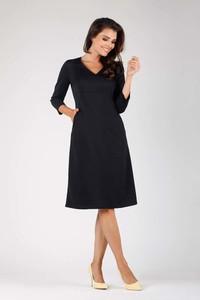 Czarna sukienka Nommo midi trapezowa z długim rękawem
