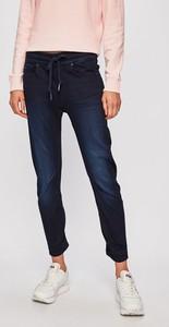 Niebieskie jeansy G-Star Raw w street stylu