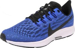 Niebieskie buty sportowe Nike sznurowane