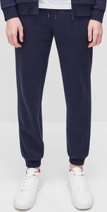 Granatowe spodnie sportowe Reserved z dresówki w stylu casual